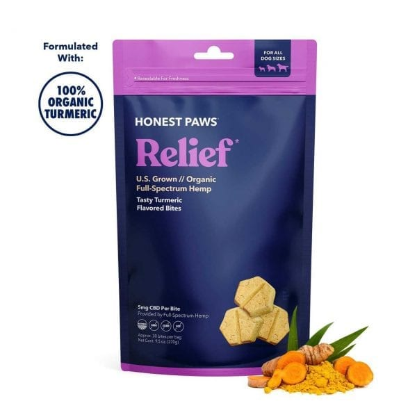 a purple and blue bag of Honest Paws CBD Relief Bites for dogs