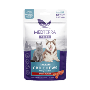 Medterra pets calming CBD chews. Bacon flavor with 300 mg per bag. Shows a grey cat and brown and white husky dog and comes in white and purple packaging with blue labeling.