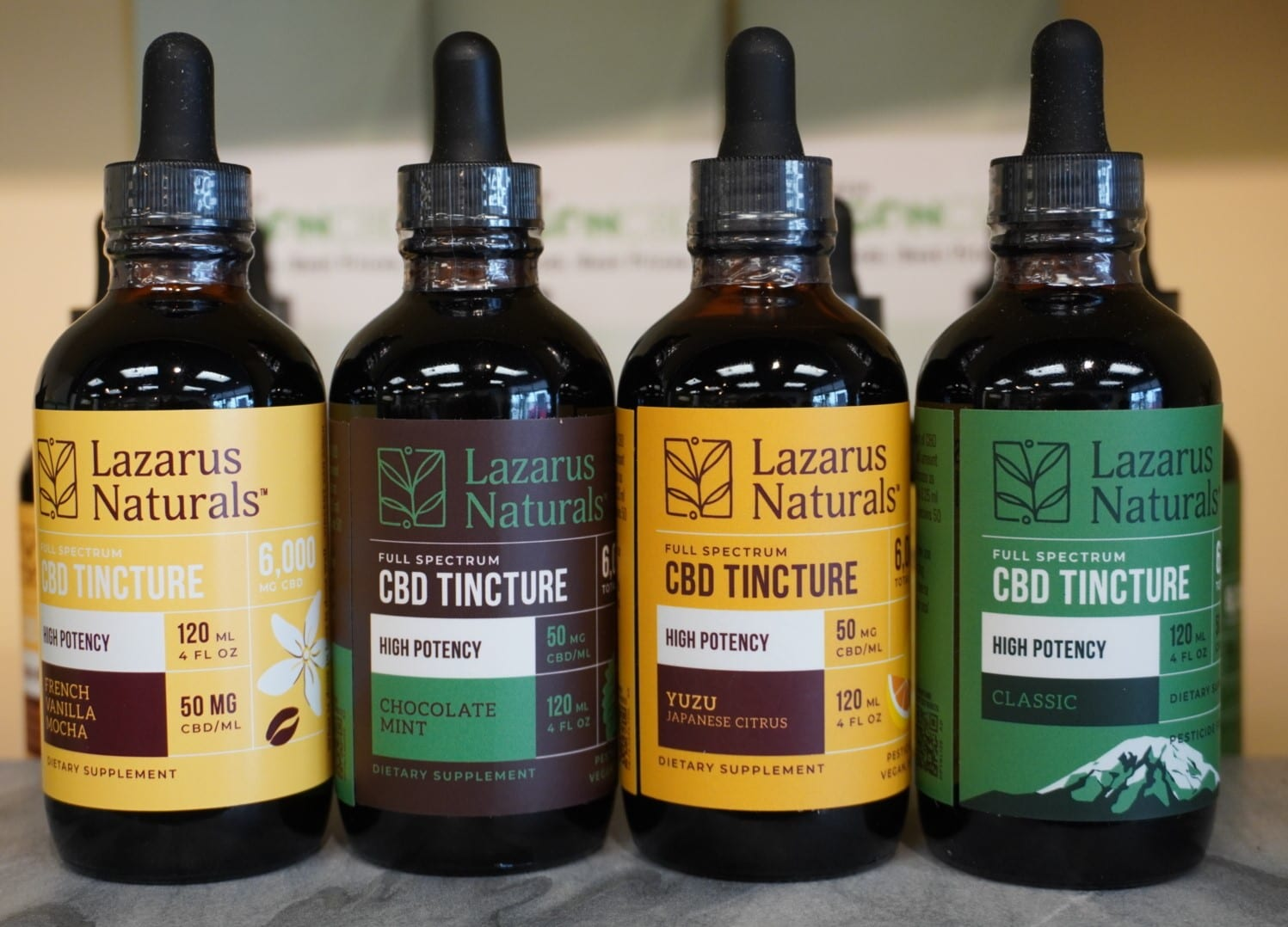 Four bottles of Lazarus Naturals CBD in 6000mg tinted bottles.