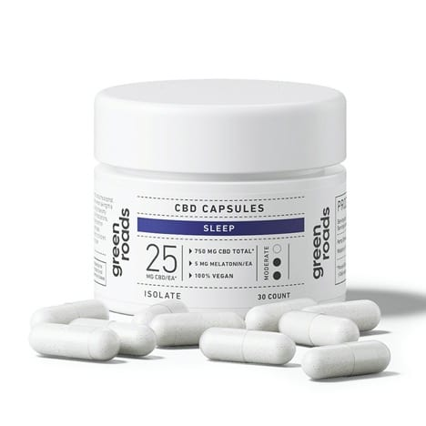 white capsules in front of one container of green roads cbd sleep capsules