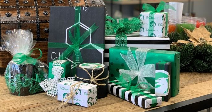 several gifts wrapped for the holidays as CBD gifts ideas from The Green Dragon CBD in green wrapping paper