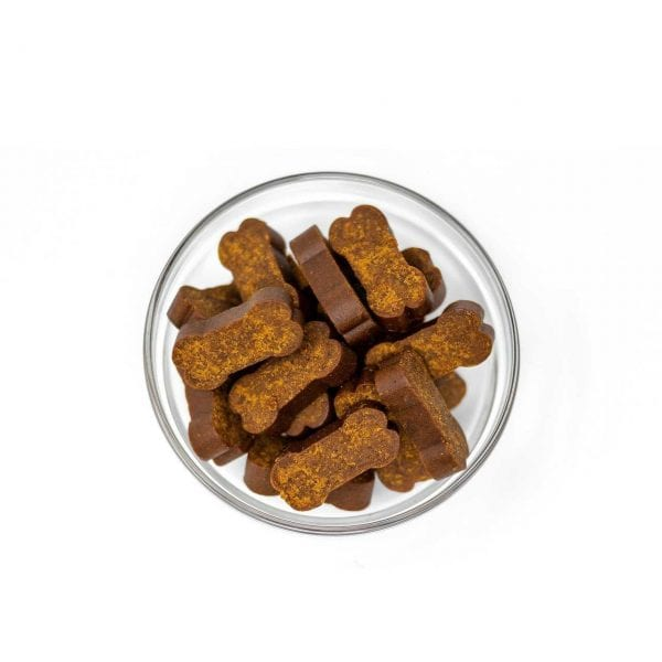 A bowl of dog treats in a glass bowl. They are CBD dog chews.