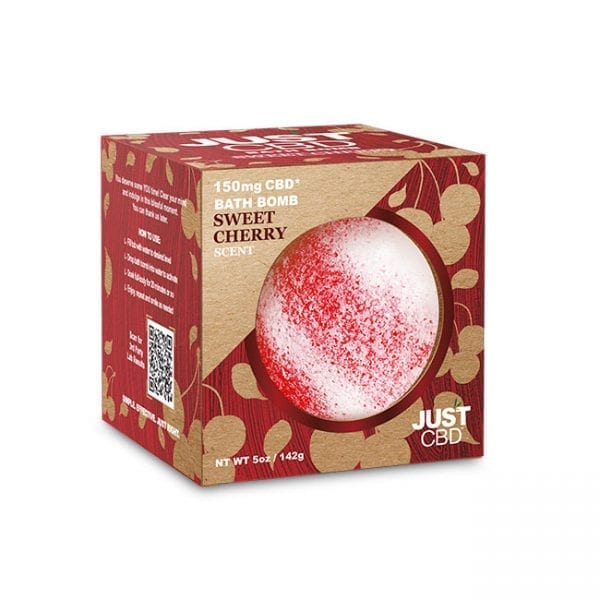 A box with a red, speckled JustCBD Cherry Bath Bomb inside, and sticking out.