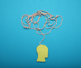 A string twisted over the diagram of a head to represent OCD