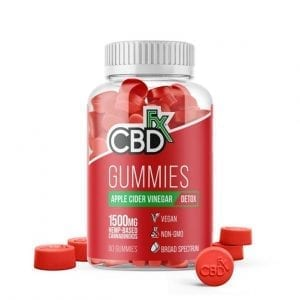A red jar of apple cider vinegar and CBD gummies.