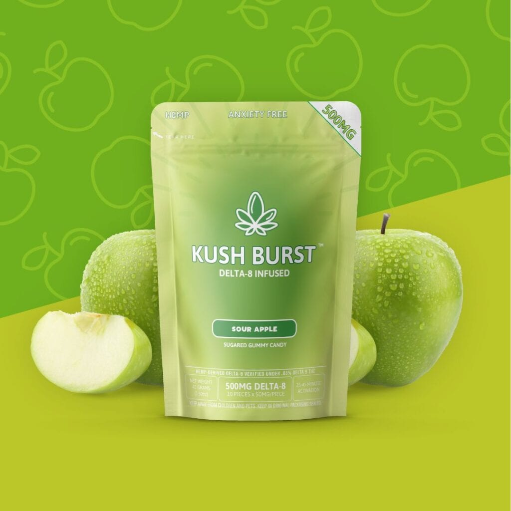 A green bag of Kush Burst Delta 8 THC gummies surrounded by whole and cut apples.