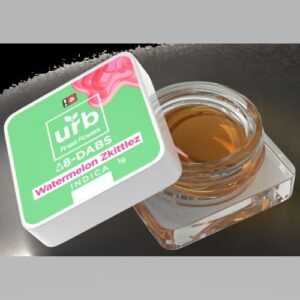 An open jar of Urb D8 Dabs in watermelon zkittlez strain showing the concentrate inside the child-proof cap