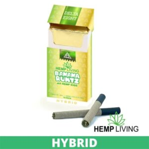 Gold and green cigarette box with white and green writing - Banana Runtz - Hybrid from Hemp Living USA, 2 crossed dark-colored cigarettes laying in front right, with Hemp Living logo. green banner that says hybrid on it at the bottom.